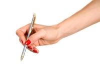 Female hand holds the pen
