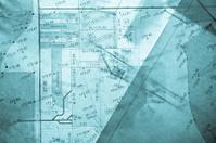different layers of blue backlit surveyor's plans