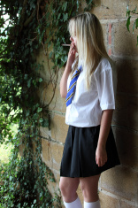 Smoking teenage schoolgirl