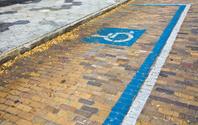 Handicap Zone Symbol Painted on Brick Street
