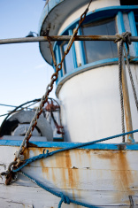 Chains, Lines and Metal Rail On Fishing Boat