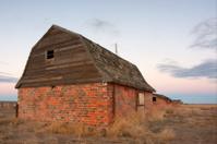 abandoned farm buildings in prairie