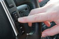 Finger pushing reduce volume button