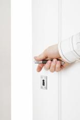 hand opening a door