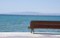 Empty bench looking the ocean