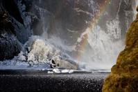 Rainbow and ice at Skogafoss, Iceland.
