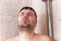 male taking shower