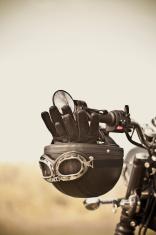 Vintage helmet and gloves on motorcycle