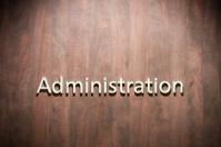 Administration - written on wooden door, copy space