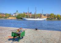 Tall ship anchored at Skeppsholmen, Stockholm. Wheelbarrow with