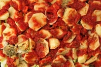 Sliced Potatos and Tomato Sauce