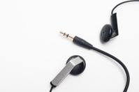 audio mini-jack plug with earphones on white