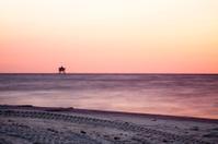 Off shore oil platform at Sunset