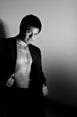 shirtless man in blazer