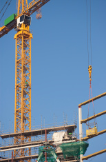 Tower Crane lowering workers in basket