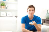 Young man watching tv