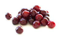Cherries heap on white