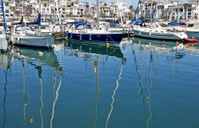 Boats and yachts moored at Duquesa port in Spain