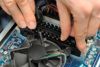 Hands installing computer parts
