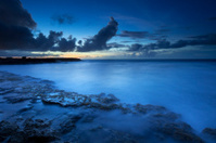 Rocky coast on the island of Curaçao at dusk