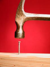 Hammer in nail