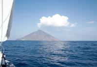 volcano and sailing boat