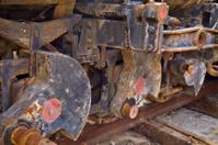 three rusty steam train wheels