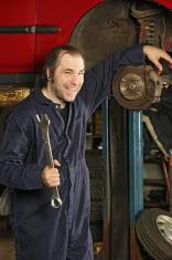 Crazy mechanic fixing the brakes