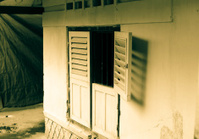 Window derelict creepy abandoned cottage in Munduk Bali