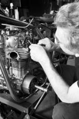 Mature man working on his classic motorbike