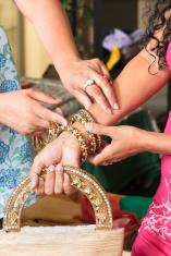 Salesperson Assisting Bracelet Shopper