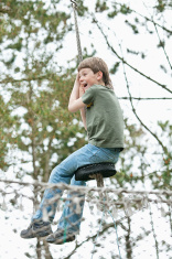 Boy hangs on a rope