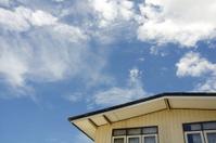 House against blue sky.