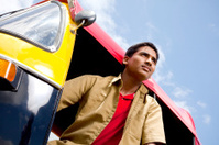Young Cheerful Indian Auto Rickshaw Driver