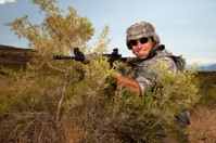 Special ops military soldier smiling in tactical position