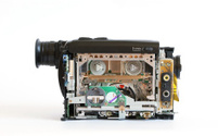 Camcorder with removed protective cover and open the internal me