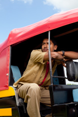 Pensive Indian Auto Rickshaw Driver