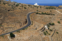 Windy road and church, Syros island, Greece