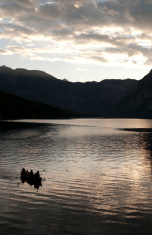 Boat on Bohinj lake Slovenia at sunset