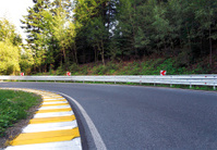 Curved road in the mountain forest
