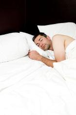 Unmade Bed,  Man Sleeping