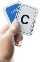 Brain cancer card dealt in life with latex glove