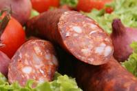 home made salami on some fresh organic salad