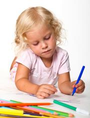 blonde kid drawing