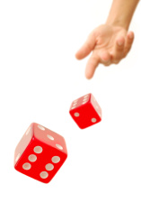 https://images.freeimages.com/images/premium/large-thumbs/1424/14242245-throwing-dice.jpg