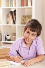 smiling boy writing