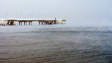 Frozen pier, lonely man