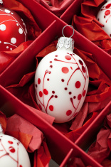 Red and white hand painted christmas baubles in box