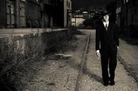 film noir style gangster walking in an alley