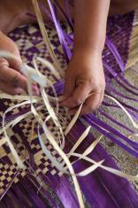 Weaving a Samoan mat